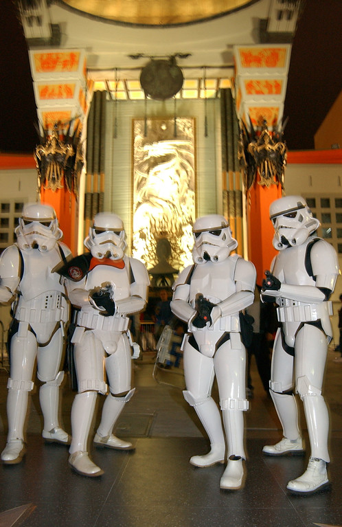 ". Fans dressed as ""stormtrooper\"" characters wait in line for the opening of \""Star Wars: Episode II, Attack of the Clones\"" outside Grauman\'s Chinese Theatre May 15, 2002 in Hollywood, CA. (Photo by Robert Mora/Getty Images)"