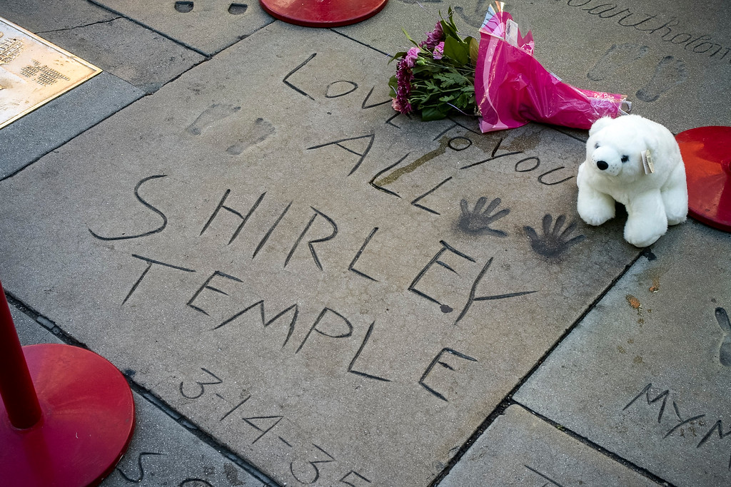. A few tributes placed in front of the Chinese Theater for Shirley Temple Black who passed away on Tuesday, February 11, 2014. (Photo by David Crane/Los Angeles Daily News)