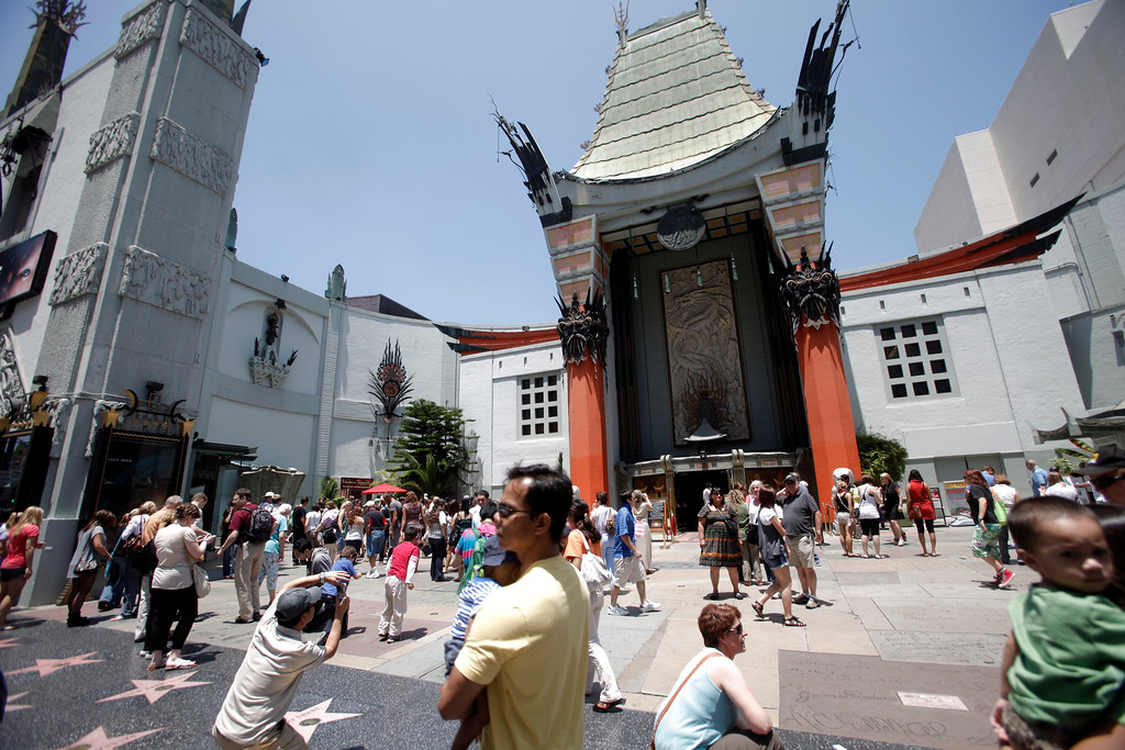 . In this 2010 file photo, tourists  at Grauman\'s Chinese Theater in Hollywood.  (Hans Gutknecht/Los Angeles Daily News)