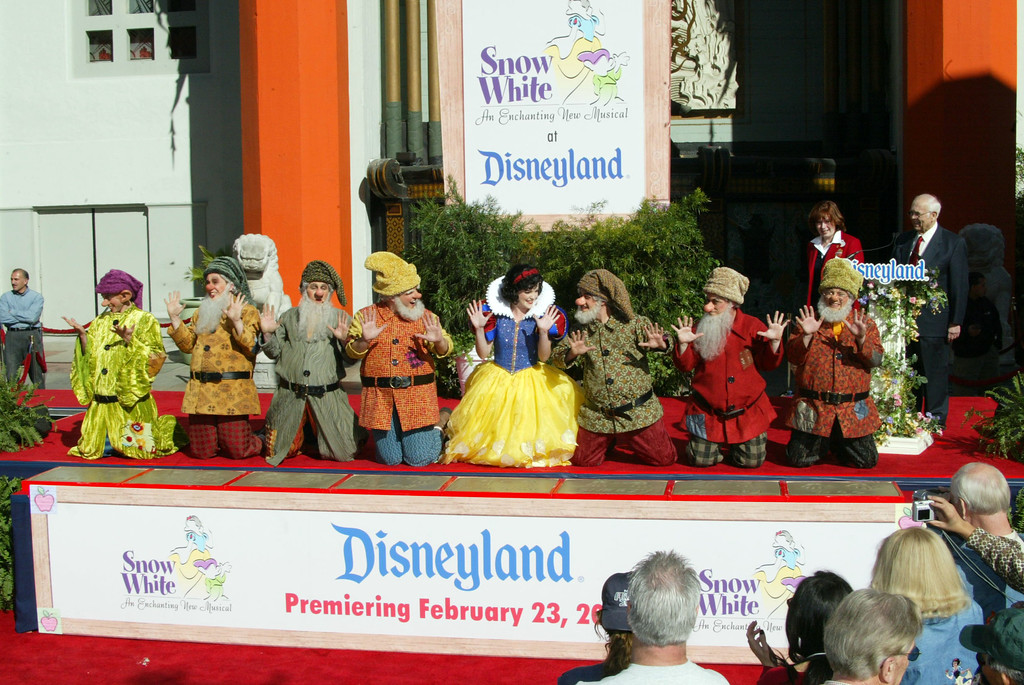 ". HOLLYWOOD - FEBRUARY 5:  Characters from the fabled Disney children\'s story and movie, ""Snow White and the Seven Dwarfs\"" attend a handprint ceremony at Grauman\'s Chinese Theatre February 5, 2004 in Hollywood, California.  (Photo by Frederick M. Brown/Getty Images)"