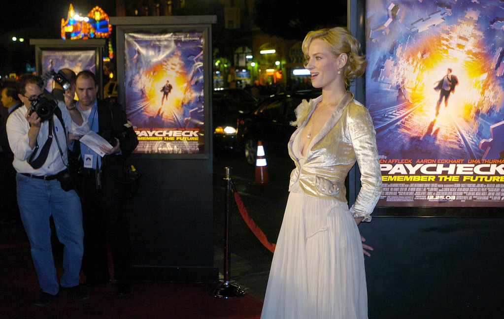 ". Uma Thurman, one of the stars of the new film ""Paycheck,\"" poses for photographers at a screening of the film at Grauman\'s Chinese Theater in Los Angeles, Thursday, Dec. 18, 2003. (AP Photo/Chris Pizzello)"