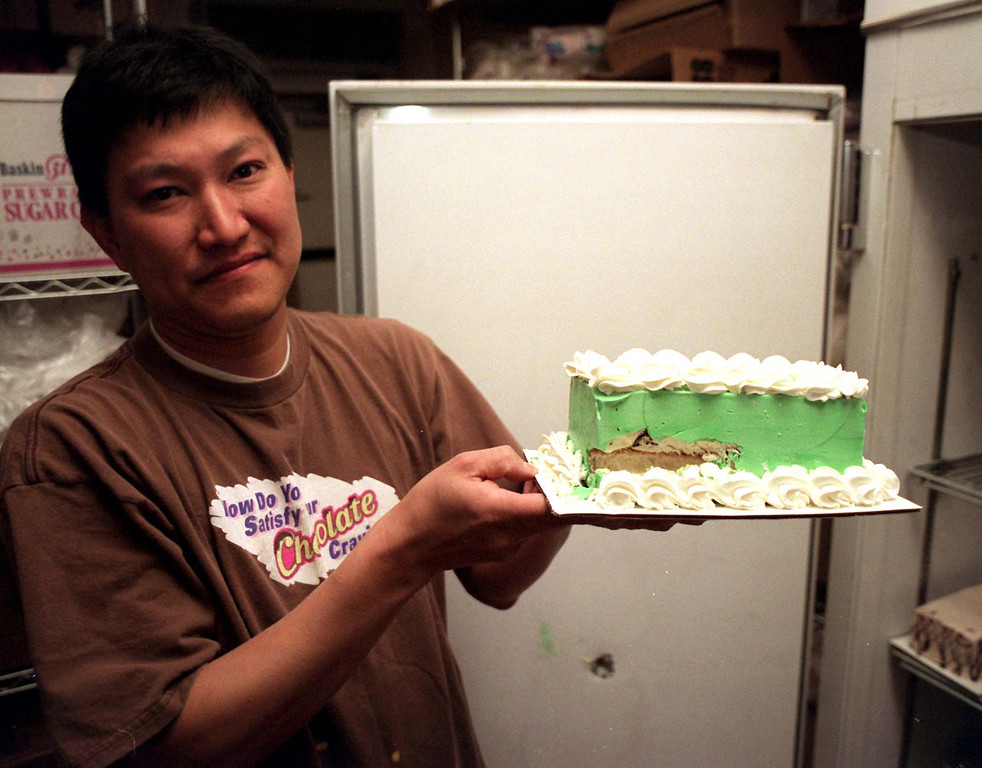 . Tienchai Surinarintr and his wife weren\'t in the store when a bullet tore through the cake freezer at Baskin Robbins.  (Los Angeles Daily News file photo)