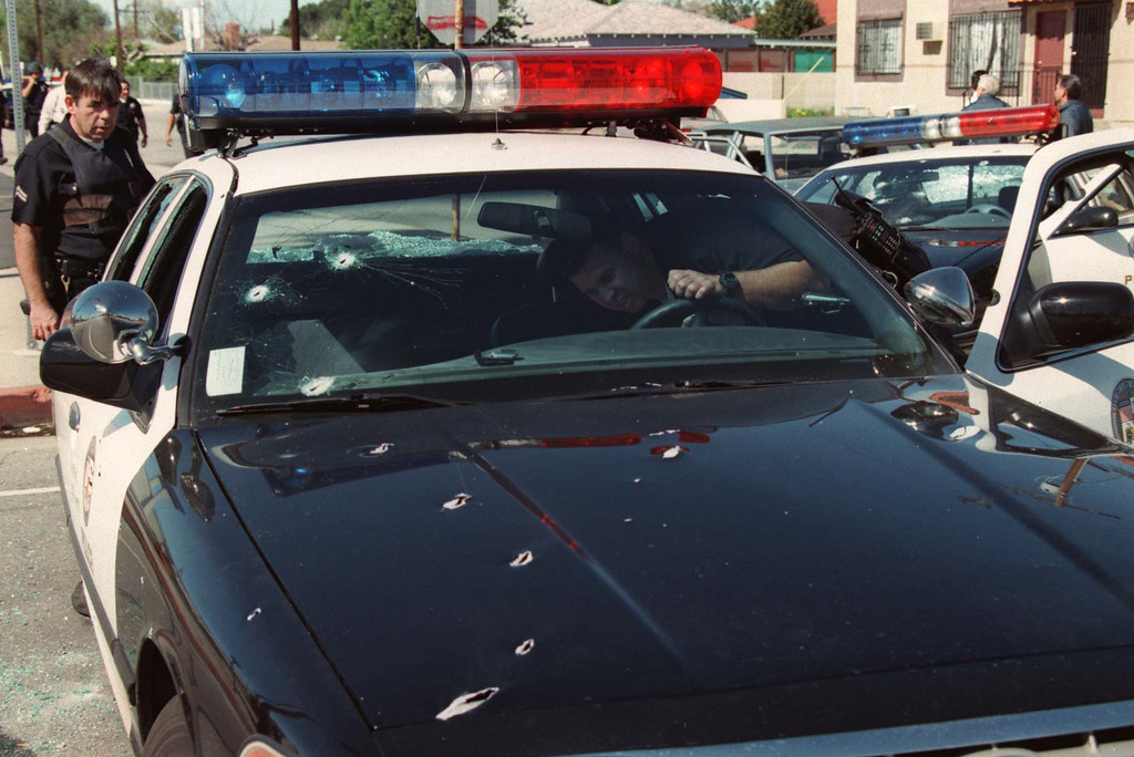 . Armed with automatic weapons and body armor, two masked men robbed a North Hollywood bank Friday, February 28, 1997, and then were killed trying to blast their way to freedom, spraying bullets into houses and cars as the world witnessed it live on television. (Gene Blevins/Los Angeles Daily News)