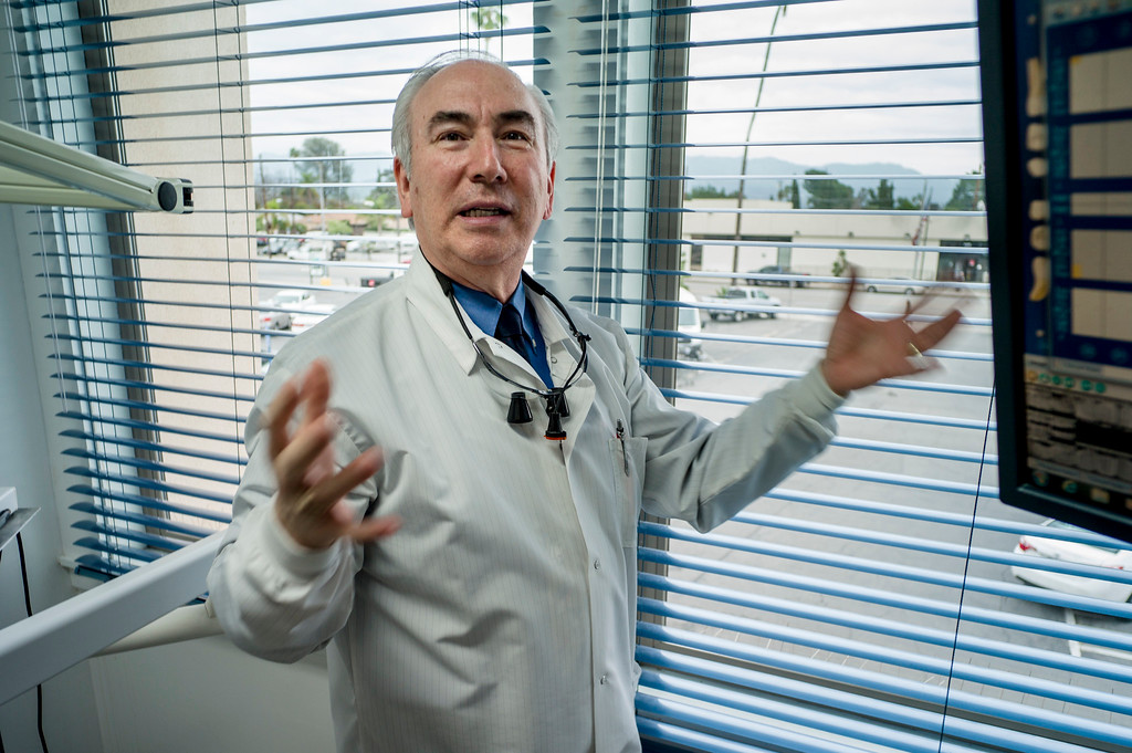 . Dr. Jorge Montes, D.D.S., shows where he watched the Bank of America shoot out from his offices across the street.  During the shooting Montes ended up treating Sgt. James Zboravan who was wounded during the shoot-out.    (Photo by David Crane, Los Angeles Daily News/SCNG)
