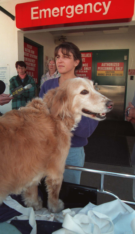 . Tracy Fisher and her pet, D.O.G., leave the North Hollywood Medical Center. Both were wounded in the North Hollywood bank shootout on Friday, February 28 1997.   (Photo by John McCoy/Los Angeles Daily News)