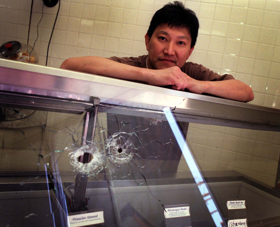. Tienchai Surinarintr\'s damaged ice cream shop stayed closed Friday, but crowds of gawkers made a good weekend.  (Los Angeles Daily News file photo)