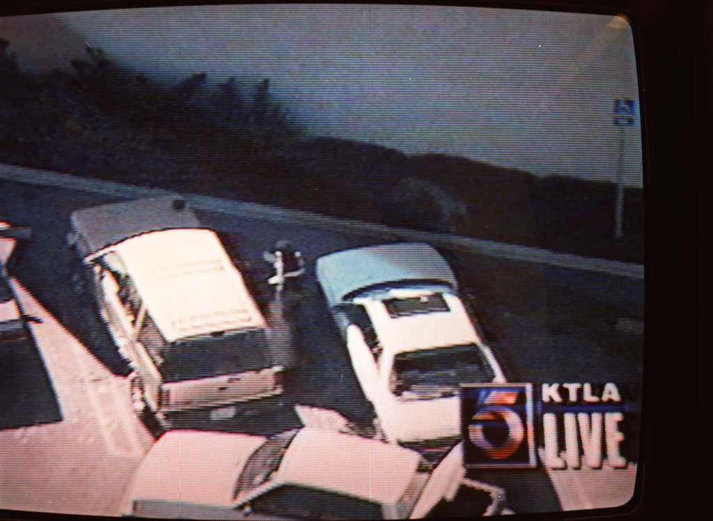 . TV helicopters broadcast live coverage of a suspect firing from the side of the bank building.   (Courtesy of KTLA-TV)