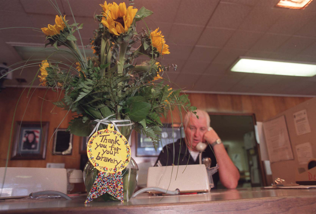 . A ``thank-you\'\' bouquet of flowers sits on a counter Monday at the North Hollywood Division.  (Los Angeles Daily News file photo)