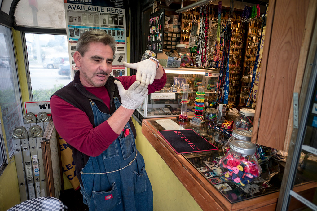 . David Lejbowicz, owner of Silvers Locksmith, explains how the stacks of key blanks stopped the rounds from going through the building.  Leibowicz, was not the owner of the shop at the time of the shooting, but was a good friend of the former owner.   (Photo by David Crane, Los Angeles Daily News/SCNG)