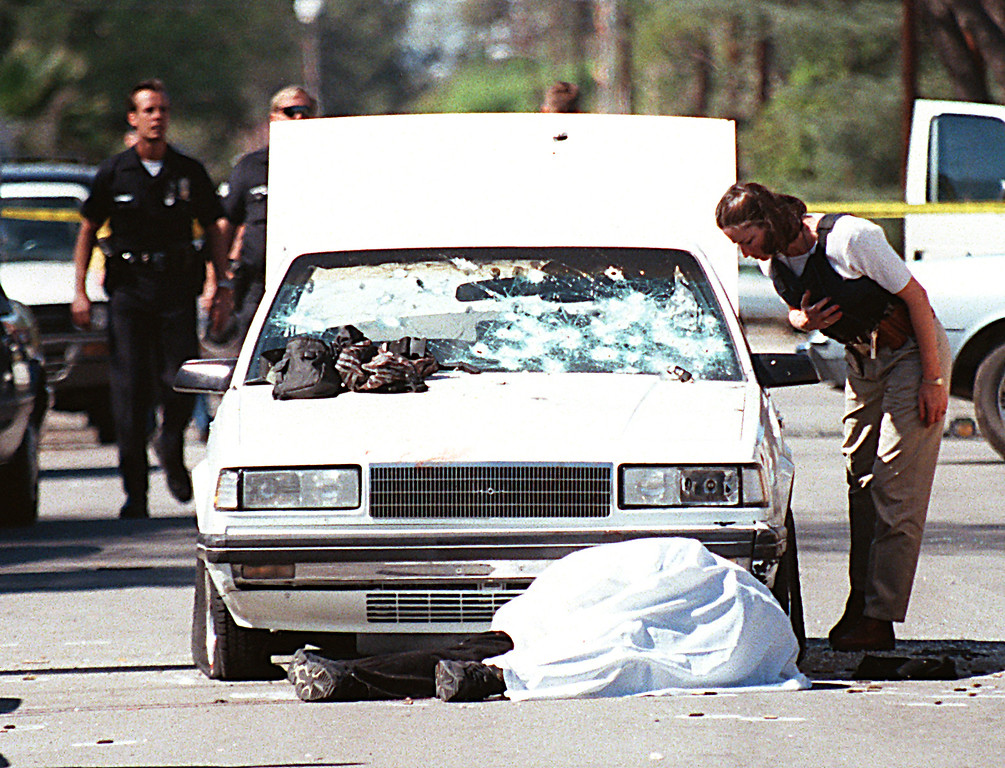 . The North Hollywood shootout was an armed confrontation between two heavily armed bank robbers and officers of the Los Angeles Police Department (LAPD) in the North Hollywood district of Los Angeles on February 28, 1997. Both robbers were killed, eleven police officers and seven civilians were injured, and numerous vehicles and other property were damaged or destroyed by the nearly 2,000 rounds of ammunition fired by the robbers and the police. (Photo by Gene Blevins/Los Angeles Daily News)