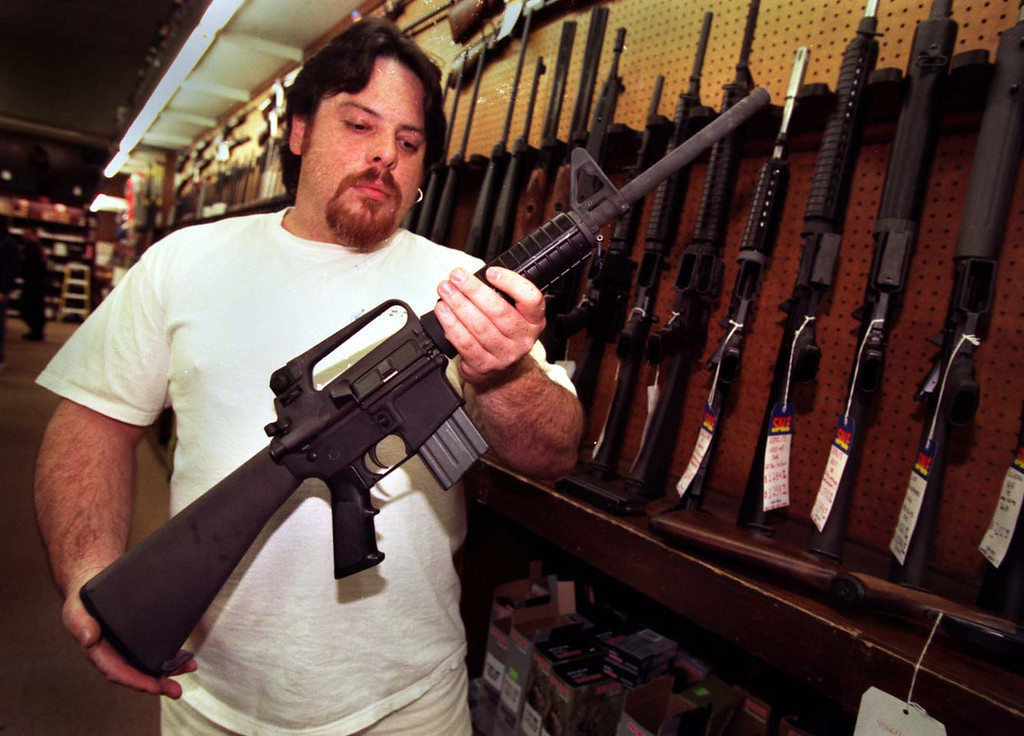 . Tony Goff of B&B Sales shows the type of semiautomatic rifle borrowed from B&B by police units Friday, February 28, 1997.   (Los Angeles Daily News file photo)