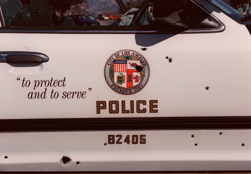 . A bullet-riddled police car.  (Photo by Gene Blevins/Los Angeles Daily News)