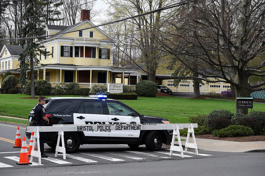 . Police block the street in front of O\'Brien Funeral Home for the funeral of Aaron Hernandez, Monday, April 24, 2017, in Bristol, Conn. The former New England Patriots tight end was found hanged in his cell in a maximum-security prison in Massachusetts on April 19, 2017. (AP Photo/Jessica Hill)