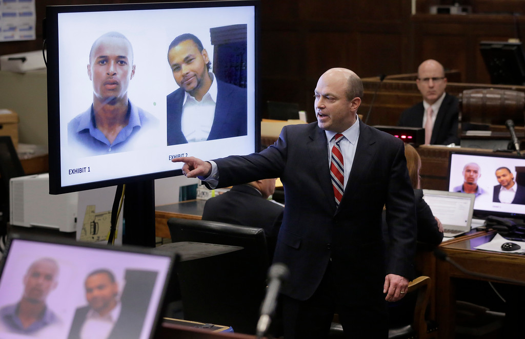 . Assistant district attorney Patrick Haggan, center, makes closing arguments in the double murder trial for former New England Patriots tight end Aaron Hernandez as images of murder victims Safiro Furtado, top left, and Daniel de Abreu, top right, are projected on a screen at Suffolk Superior Court, Thursday, April 6, 2017, in Boston. Hernandez is on trial for the July 2012 killings of Daniel de Abreu and Safiro Furtado who he encountered in a Boston nightclub. The former NFL player is already serving a life sentence in the 2013 killing of semi-professional football player Odin Lloyd. (AP Photo/Steven Senne, Pool)
