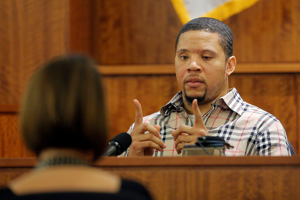 . Prosecution witness Alexander Bradley describes a gun he saw with former New England Patriots NFL football player Aaron Hernandez on a trip to Florida as Bradley testifies during Hernandez\'s murder trial, Wednesday, April 1, 2015, at Bristol County Superior Court in Fall River, Mass. Hernandez is accused of killing Odin Lloyd in June 2013.  (AP Photo/Brian Snyder, Pool)