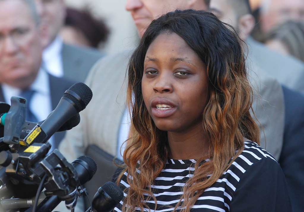. Odin Lloyd\'s younger sister, Olivia Thibault, speaks with the media  outside Bristol County Superior Court Wednesday, April 15, 2015, in Fall River, Mass., after former New England Patriots NFL football player Aaron Hernandez was found guilty of murder in the shooting death of Lloyd. (AP Photo/Stew Milne)