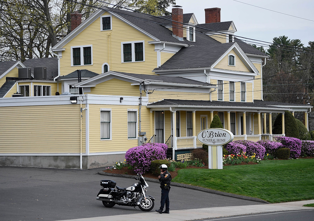 . Police block the street in front of O\'Brien Funeral Home for the funeral of Aaron Hernandez, Monday, April 24, 2017, in Bristol, Conn. The former New England Patriots tight end was found hanged in his cell in a maximum-security prison in Massachusetts April 19, 2017. (AP Photo/Jessica Hill)