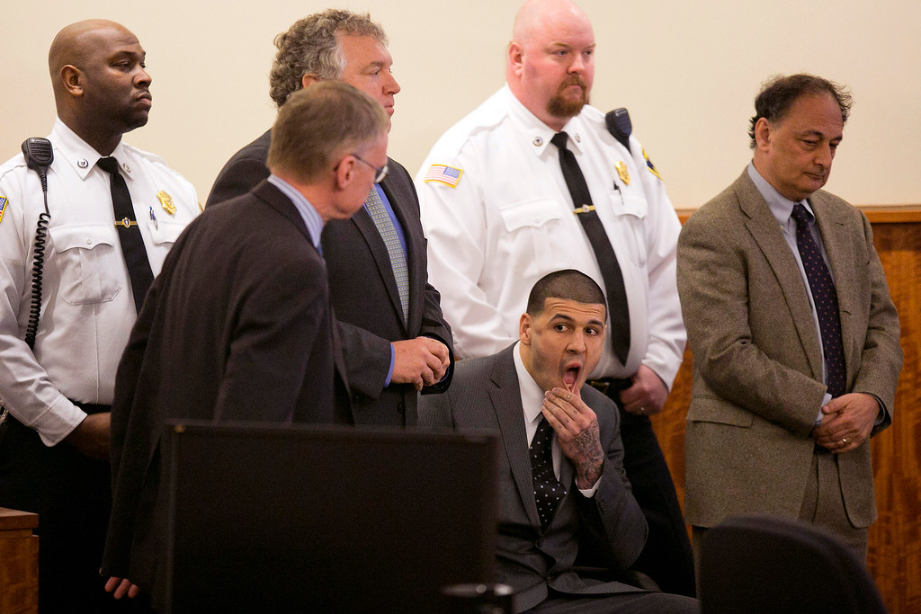 . Former New England Patriots football player Aaron Hernandez awaits the verdict during his murder trial at the Bristol County Superior Court in Fall River, Mass., Wednesday, April 15, 2015.  Hernandez was found guilty of first-degree murder in the shooting death of Odin Lloyd in June 2013.  He faces a mandatory sentence of life in prison without parole.  (Dominick Reuter/Pool Photo via AP)