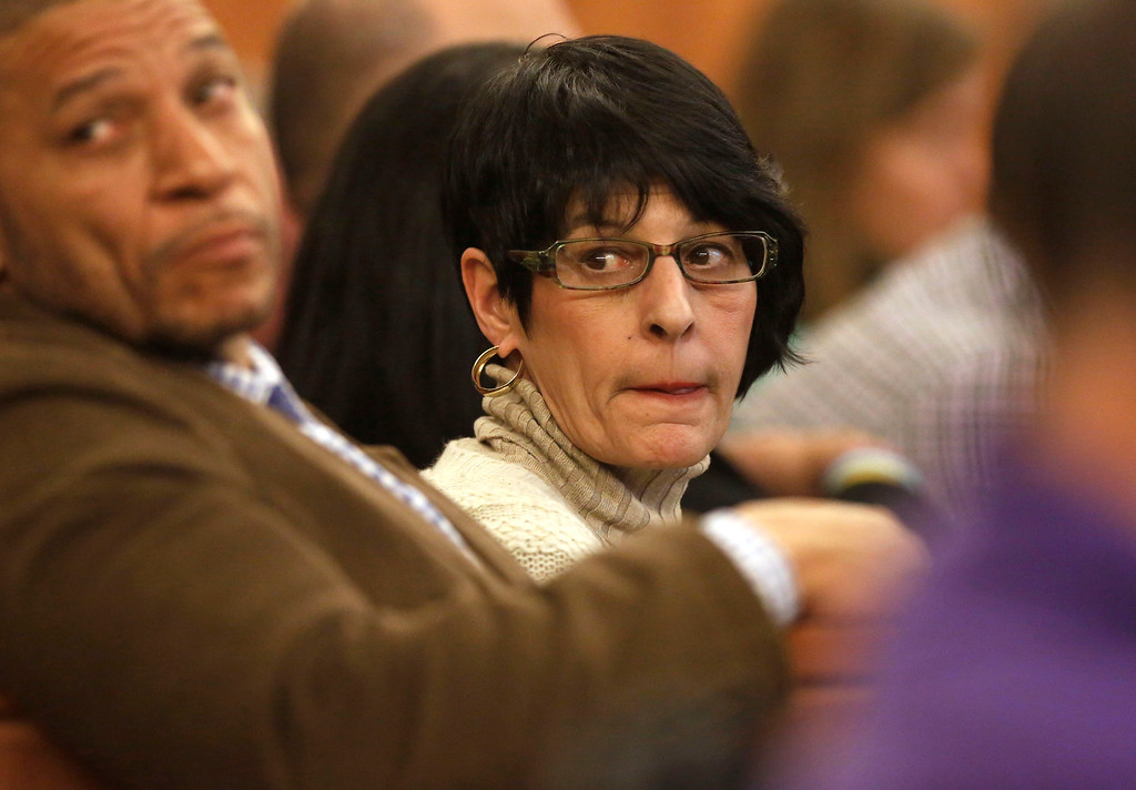 . Terri Hernandez, center, mother of former New England Patriots NFL football player Aaron Hernandez, watches during her son\'s murder trial, Thursday, Jan. 29, 2015, in Fall River, Mass. Hernandez is charged with killing semiprofessional football player Odin Lloyd, 27, in June 2013.  (AP Photo/Steven Senne, Pool)