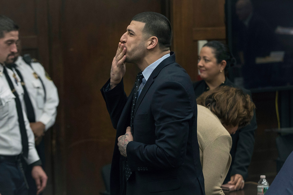 . Former New England Patriots tight end Aaron Hernandez blows a kiss to his daughter, who sat with her mother, Shayanna Jenkins Hernandez, Hernandez\'s longtime fiancee, during jury deliberations in his double-murder trial at Suffolk Superior Court in Boston, Wednesday, April 12, 2017. Hernandez is charged in the July 2012 killings of Daniel de Abreu and Safiro Furtado, who he encountered in a Boston nightclub. The former NFL football player already is serving a life sentence in the 2013 killing of semi-professional football player Odin Lloyd. (Keith Bedford /The Boston Globe via AP, Pool)