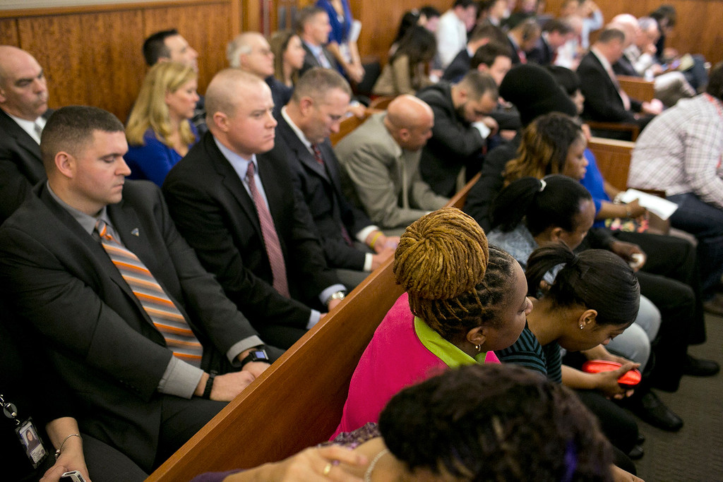 . The public gallery sits after former New England Patriots football player Aaron Hernandez was convicted in his murder trial at the Bristol County Superior Court in Fall River, Mass., on Wednesday, April 15, 2015.  Hernandez was found guilty of first-degree murder in the shooting death of Odin Lloyd in June 2013.  He was sentenced to life in prison.  (Dominick Reuter/Pool Photo via AP)