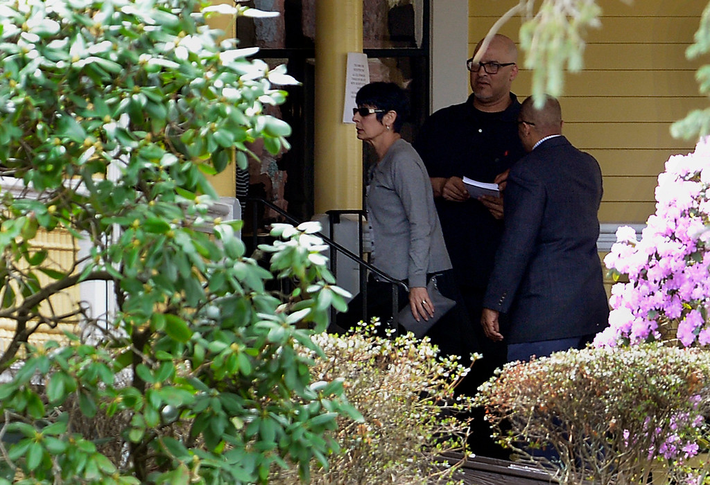 . Terri Hernandez, left, arrives at the O\'Brien Funeral Home for a private service for her son Aaron Hernandez, Monday, April 24, 2017, in Bristol, Conn. The former New England Patriots tight end was found hanged in his cell in a maximum-security prison in Wednesday. (AP Photo/Jessica Hill)