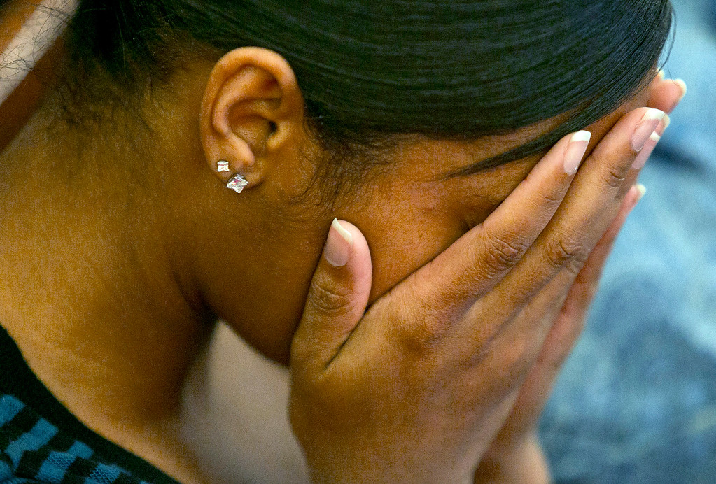 . Shaneah Jenkins, girlfriend of victim Odin Lloyd, cries as former New England Patriots NFL football player Aaron Hernandez is found guilty verdict during his murder trial, Wednesday, April 15, 2015, at the Bristol County Superior Court in Fall River, Mass. Hernandez was found guilty of first-degree murder in the shooting death of Lloyd in June 2013.  He faces a mandatory sentence of life in prison without parole. (Dominick Reuter/Pool Photo via AP)
