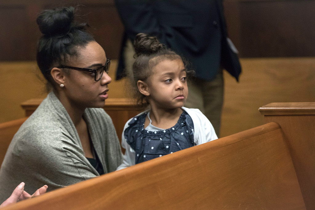 . Shayanna Jenkins Hernandez, fiancee of former New England Patriots tight end Aaron Hernandez, sits in the courtroom with the couple\'s daughter during jury deliberations in Hernandez\'s double-murder trial at Suffolk Superior Court in Boston, Wednesday, April 12, 2017. Hernandez is charged in the July 2012 killings of Daniel de Abreu and Safiro Furtado, who he encountered in a Boston nightclub. The former NFL football player already is serving a life sentence in the 2013 killing of semi-professional football player Odin Lloyd. (Keith Bedford /The Boston Globe via AP, Pool)