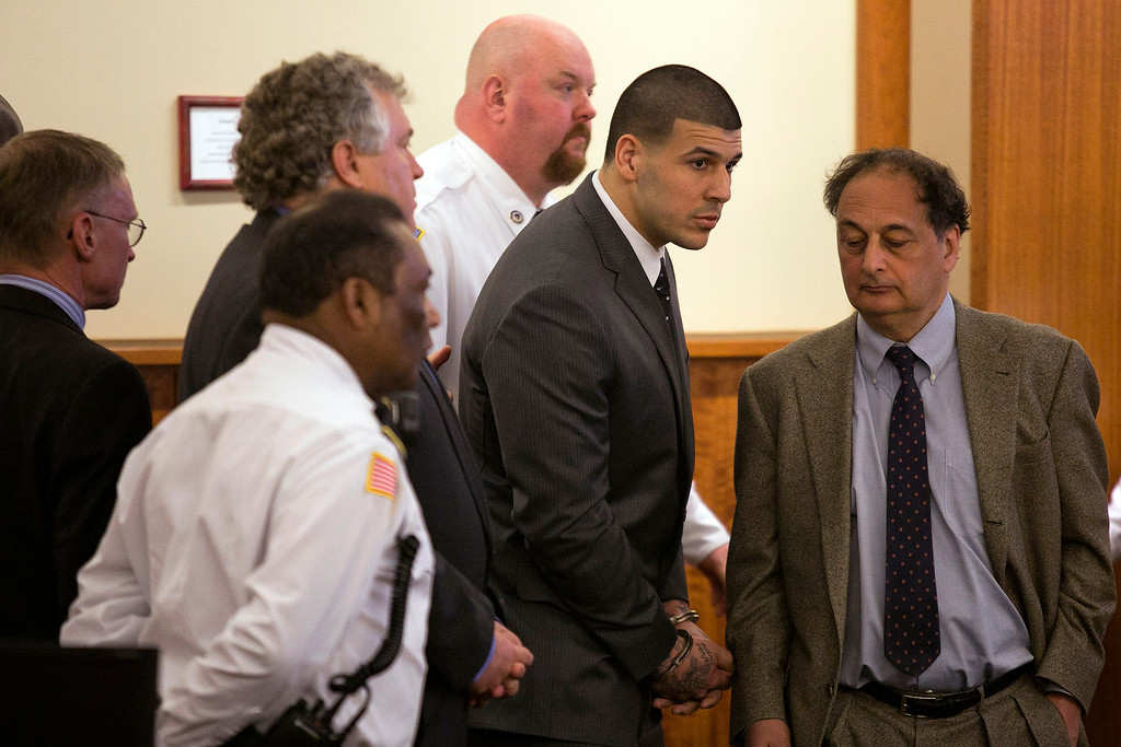 . Former New England Patriots football player Aaron Hernandez stands up after he is sentenced to life in prison at his murder trial at the Bristol County Superior Court in Fall River, Mass., on Wednesday, April 15, 2015.  Hernandez was found guilty of first-degree murder in the shooting death of Odin Lloyd in June 2013.   (Dominick Reuter/Pool Photo via AP)
