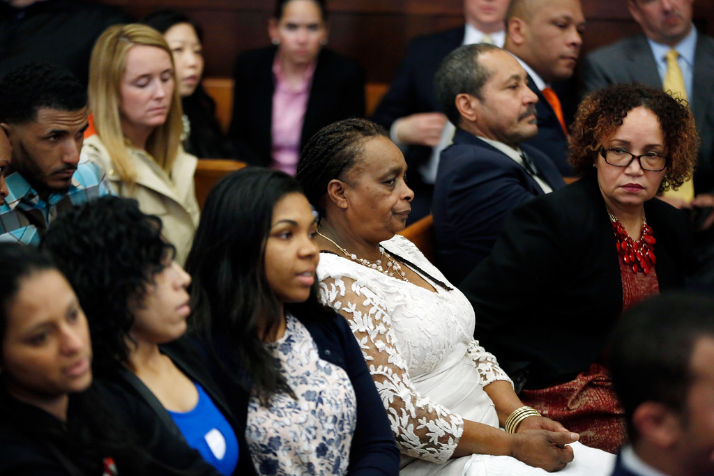 . Family and friends of Daniel de Abreu and Safiro Furtado listen to the judge speak to the jury in defendant Aaron Hernandez\'s trial at Suffolk Superior Court, Tuesday, April 11, 2017, in Boston. Hernandez is on trial for the July 2012 killings of Daniel de Abreu and Safiro Furtado who he encountered in a Boston nightclub. The former New England Patriots NFL player is already serving a life sentence in the 2013 killing of semi-professional football player Odin Lloyd. (AP Photo/Elise Amendola, Pool)