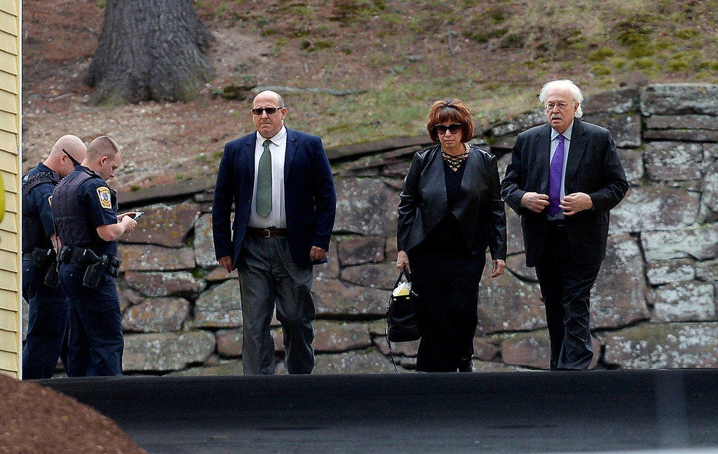 . Linda Kenney Baden, center, a defense attorney for Aaron Hernandez, arrives with her husband, right, forensic pathologist Michael Baden, for a private service for Hernandez at O\'Brien Funeral Home, Monday, April 24, 2017, in Bristol, Conn. The former New England Patriots tight end was found hanged in his cell in a maximum-security prison Wednesday. (AP Photo/Jessica Hill)
