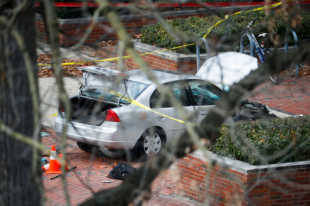 . A car inside a police line sits on the sidewalk as authorities respond to an attack on campus at Ohio State University, Monday, Nov. 28, 2016, in Columbus, Ohio. (AP Photo/John Minchillo)