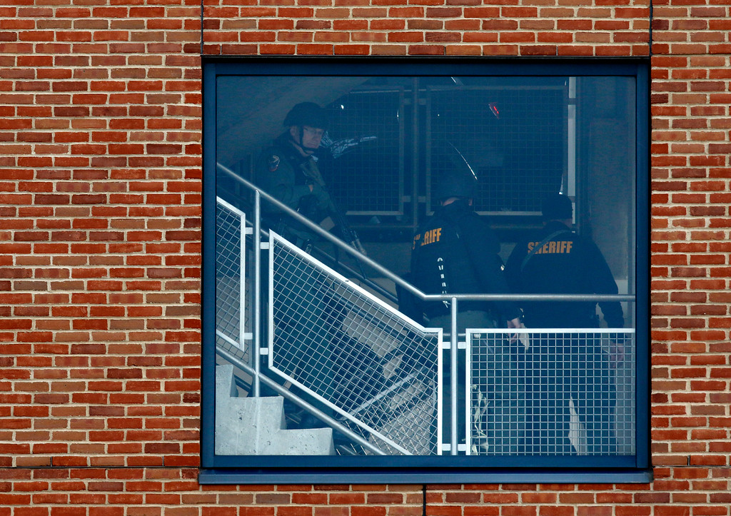 . Law enforcement officials are seen searching inside of a parking garage on the campus of Ohio State University as they respond to an active shooting in Columbus, Ohio, November 28, 2016. At least eight people were injured when an attacker apparently drove into a crowd at Ohio State University triggering an hours-long lockdown before authorities declared the campus secure. Law enforcement shot and killed one suspect, according to local television station WBNS, which reported that police led two people out in handcuffs from a garage they had surrounded on the university\'s main campus in Columbus.   (PAUL VERNON/AFP/Getty Images)
