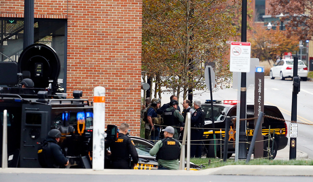. Law enforcement officers work around a parking garage in response to an attack on the campus of Ohio State University on Monday, Nov. 28, 2016, in Columbus, Ohio. (AP Photo/Jay LaPrete)