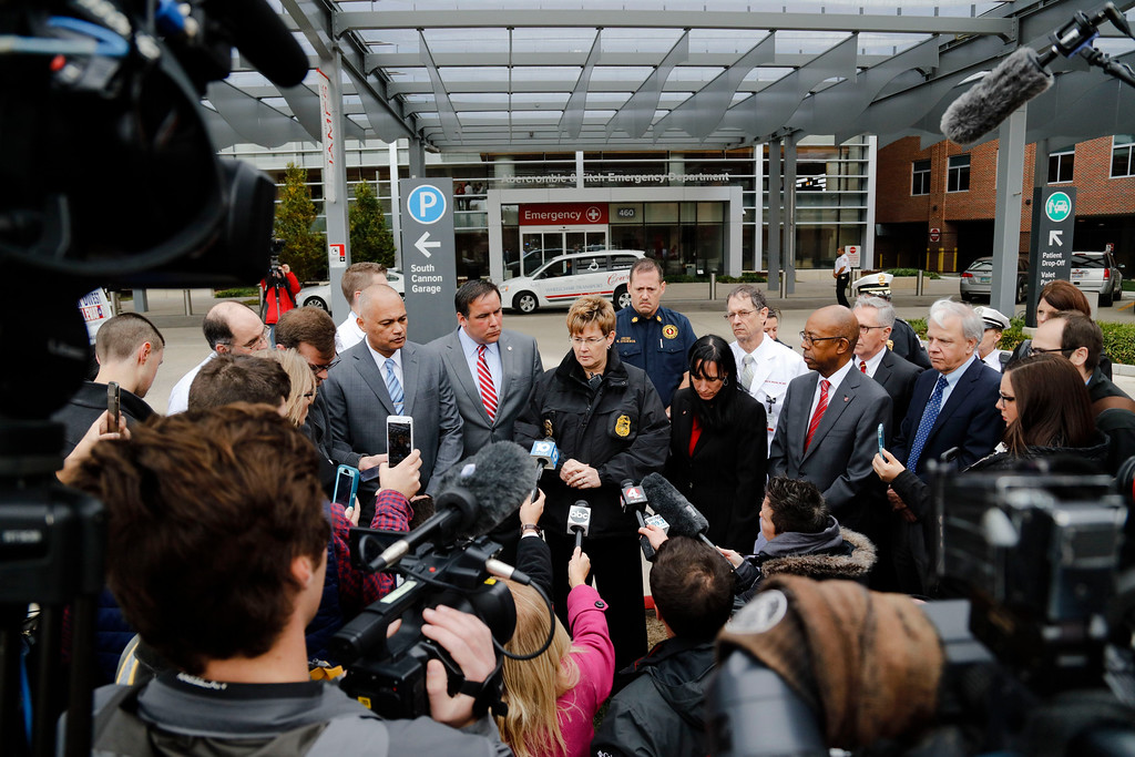 . Columbus police chief Kim Jacobs, center, speaks at a press conference outside the Wexner Medical Center following an attack on the campus of Ohio State University on Monday, Nov. 28, 2016, in Columbus, Ohio. Nine people were hospitalized after a man ran into pedestrians with his car then exited his vehicle and began cutting victims with a butcher knife. (Joshua A. Bickel/The Columbus Dispatch via AP)