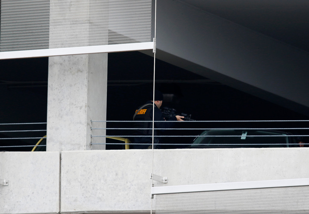 . Law enforcement officials are seen searching in a parking garage on the campus of Ohio State University as they respond to an active attack in Columbus, Ohio, on November 28, 2016. Eight people were injured when an attacker apparently drove into a crowd at Ohio State University on Monday, triggering an hours-long lockdown before authorities declared the campus secure. Law enforcement shot and killed one suspect, according to local television station WBNS, which reported that police led two people out in handcuffs from a garage they had surrounded on the university\'s main campus in Columbus.   (PAUL VERNON/AFP/Getty Images)