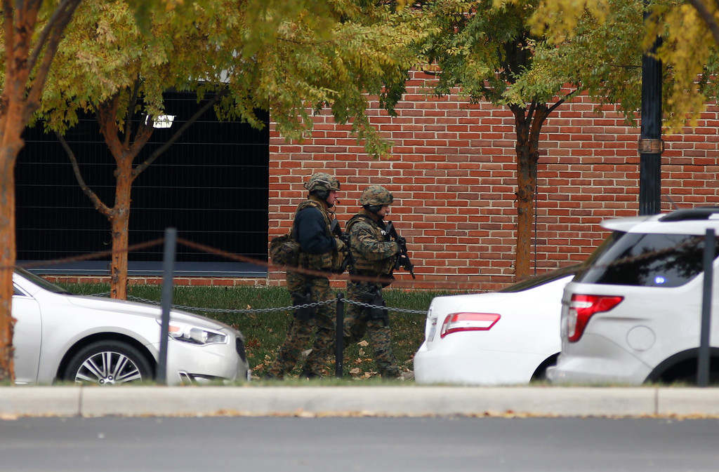 . Law enforcement patrols outside of a parking garage after an attack on the campus of Ohio State University on Monday, Nov. 28, 2016, in Columbus, Ohio. (AP Photo/Jay LaPrete)