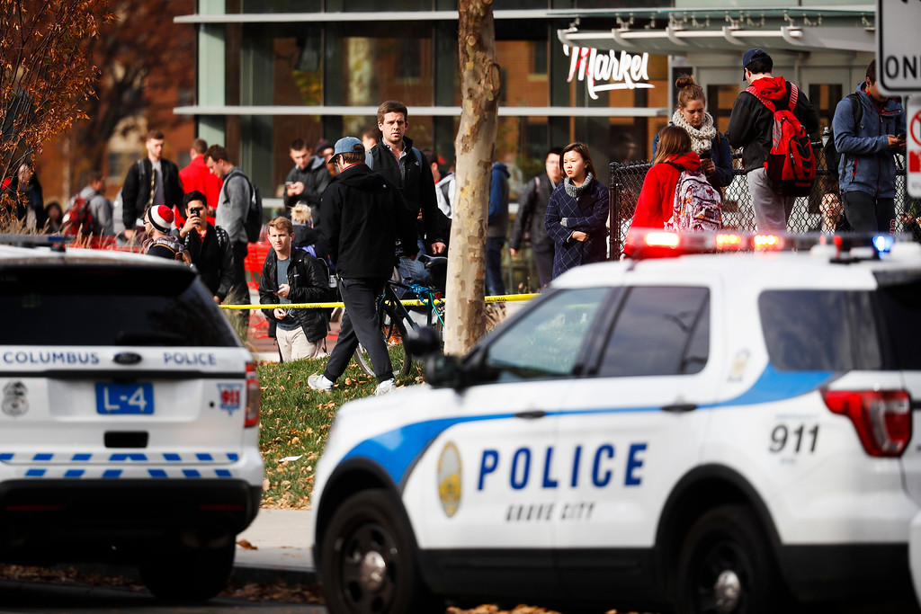 . Students leave buildings surrounding Watts Hall as police respond to reports of a shooting on campus at Ohio State University, Monday, Nov. 28, 2016, in Columbus, Ohio. (AP Photo/John Minchillo)