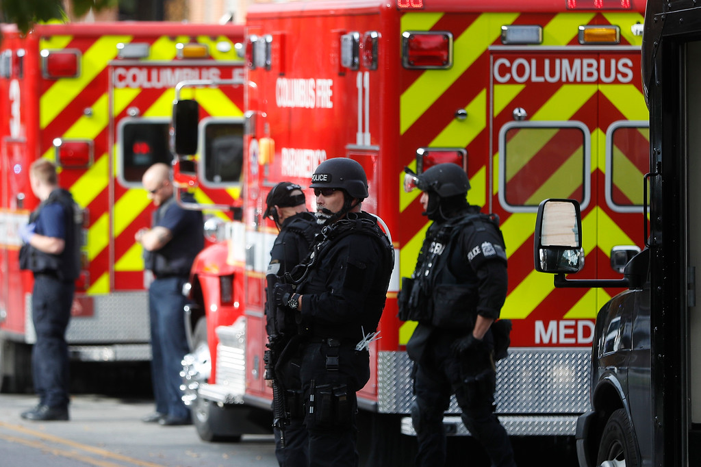 . SWAT teams and police respond to reports of a shooting on campus at Ohio State University, Monday, Nov. 28, 2016, in Columbus, Ohio. (AP Photo/John Minchillo)