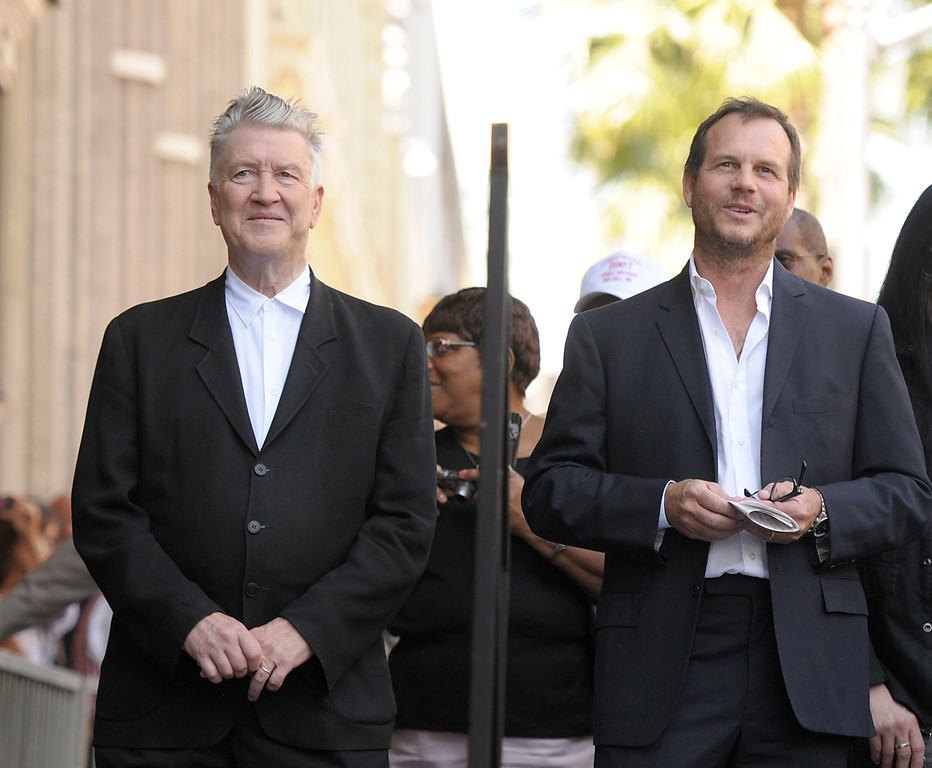 . Director David Lynch, left, and actor Bill Paxton look on as actress Sissy Spacek receives a star on the Hollywood Walk of Fame in Los Angeles on Monday, Aug. 1, 2011. (AP Photo/Dan Steinberg)