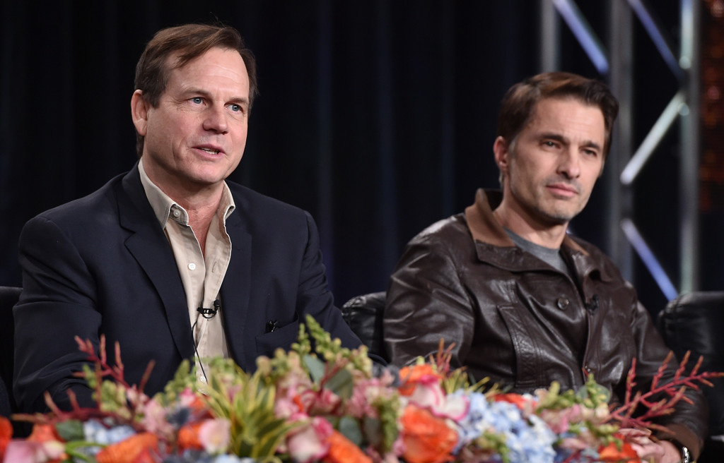 """. Bill Paxton, left, and Olivier Martinez, of History\'s \""""Texas Rising\"""", speak on stage at the Lifetime, A&E, and History winter TCA panel at the Langham Hotel on Friday, Jan. 9, 2015, in Pasadena, Calif. (Photo by John Shearer/Invision for A&E Networks]/AP Images)"""