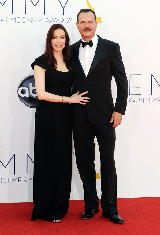 . Actor Bill Paxton, right and wife Louise Newbury arrive at the 64th Primetime Emmy Awards at the Nokia Theatre on Sunday, Sept. 23, 2012, in Los Angeles. (Photo by Matt Sayles/Invision/AP)