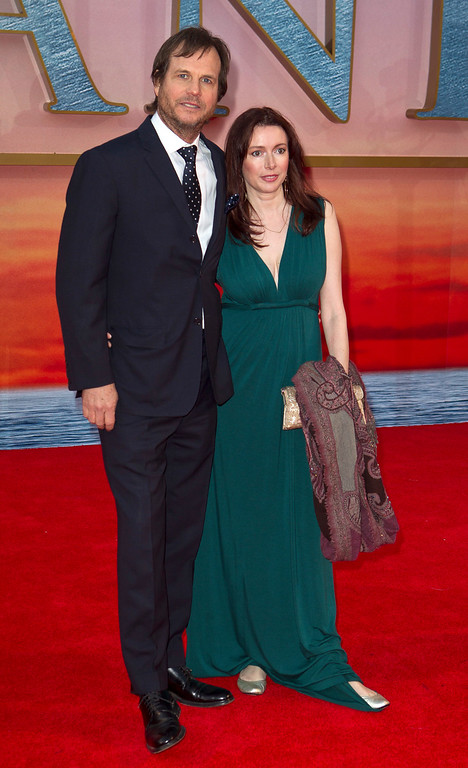 . Actor Bill Paxton, left, arrives with his wife, Louise Newbury, at the \'Titanic 3D\' UK film premiere at the Royal Albert Hall in Kensington, West London, Tuesday, March 27, 2012. The re-launch of the Titanic 3D version comes 15 years after the film was a huge box office hit. (AP Photo/Joel Ryan)