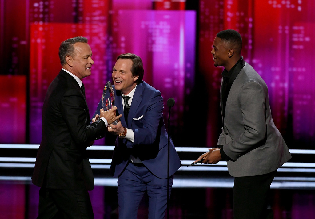 . LOS ANGELES, CA - JANUARY 18:  Actor Tom Hanks (L) accepts Favorite Dramatic Movie Actor from actors Bill Paxton (C) and Justin Cornwell (R) onstage during the People\'s Choice Awards 2017 at Microsoft Theater on January 18, 2017 in Los Angeles, California.  (Photo by Kevin Winter/Getty Images)