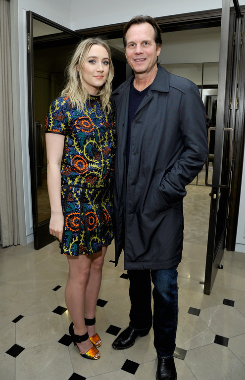 . BEVERLY HILLS, CA - JANUARY 05:  Actors Saoirse Ronan, wearing Burberry (L) and Bill Paxton at Burberry and Fox Searchlight Pictures honour the cast and filmmakers of \'Brooklyn\' at Burberry on January 5, 2016 in Beverly Hills, California.  (Photo by John Sciulli/Getty Images for Burberry)