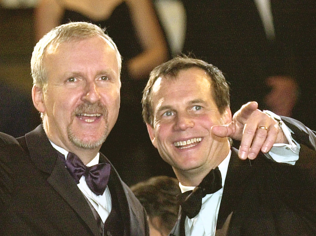 """. Canadian director James Cameron, left, and American actor Bill Paxton, right, smile as they arrive for the screening of the documentary\""""Ghosts Of The Abyss,\"""" out of competition, directed by Cameron, during the 56th Film Festival in Cannes, France, Saturday, May 17, 2003.(Patrick Gardin)"""