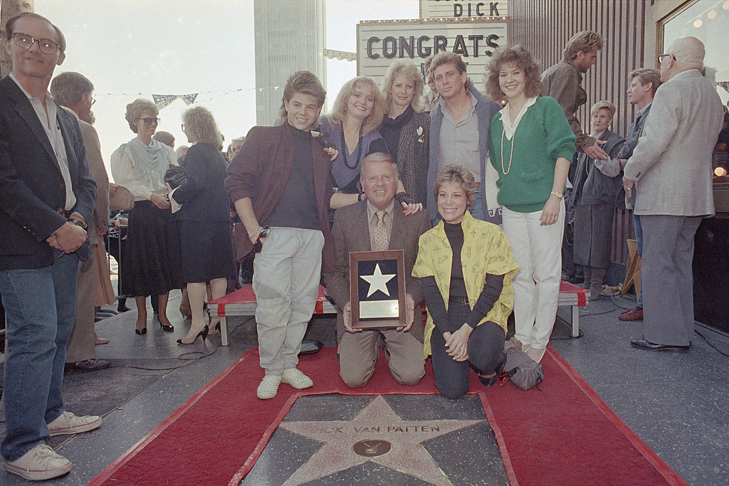 . Actor Dick Van Patten, surrounded by his family, poses with his star on the Hollywood Walk of Fame on Hollywood Boulevard, Nov. 21, 1985.   (AP Photo/Reed Saxon)