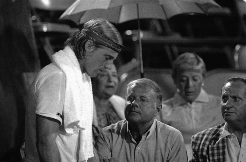 . Vince Van Patten, left, competing in the U.S. Open tennis tournament at Flushing Meadows in New York, Sept. 2, 1981 speaks to his father, actor Dick Van Patten during a break in the action.  (AP Photo/Ron Frehm)