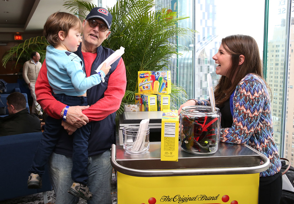""". Jeffrey Tambor and grandson grab a Popsicle® pop from the Popsicle® freezer cart at the exclusive \""""Rio 2\"""" Movie screening after-party, on Sunday, March 30, 2014 in New York.  (Photo by Amy Sussman/Invision for Popsicle/AP Images)"""