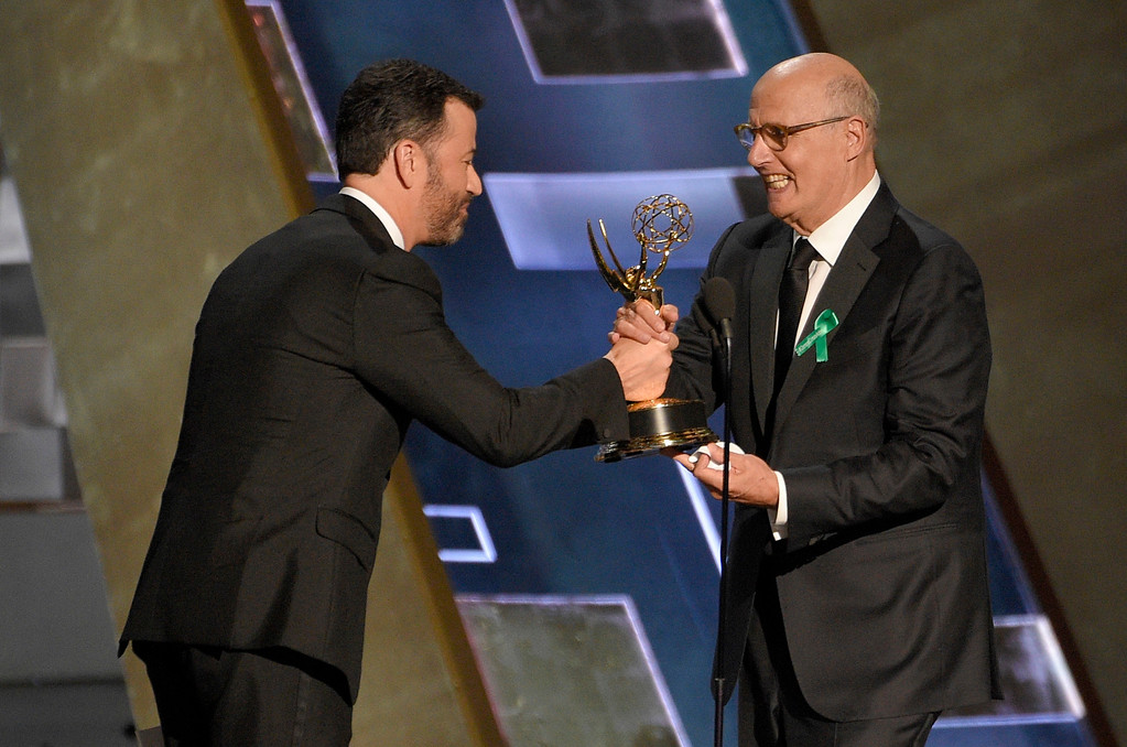 . Jimmy Kimmel presents Jeffrey Tambor the award for outstanding lead actor in a comedy series during the 67th Annual Emmy Awards show on Sunday, Sept. 20, 2015 at the Microsoft Theater in Los Angeles, California. (Photo by Scott Varley, Los Angeles Daily News/SCNG)